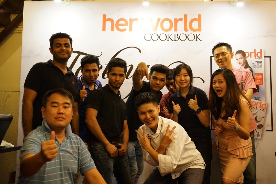 Chef Yenni Law is incredibly grateful for the conviction and support of her team and her partner, Hoo Sze Ling (front row, far right).