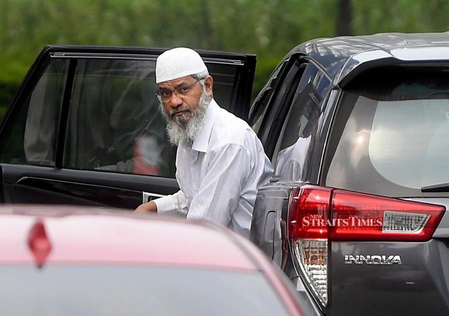 Dr Zakir Naik seen arriving at the Bukit Aman police headquarters to have his statement recorded. - Bernama pic
